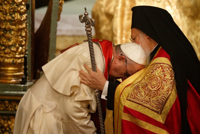 Pope Francis, Ecumenical Patriarch Bartholomew of Constantinople embrace during prayer service in Istanbul